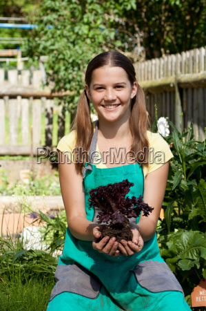 girl with salad in garden
