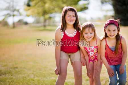 3 young girls standing in line
