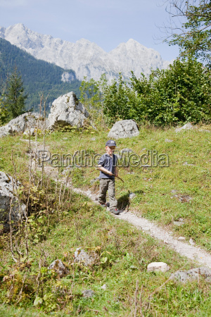 boy coming down a hill