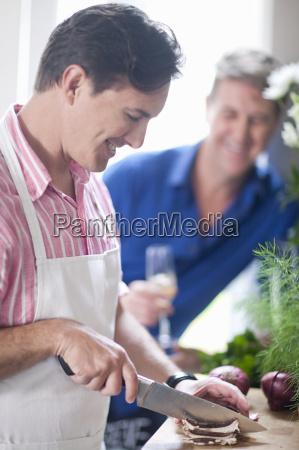 mature man chopping red onion man