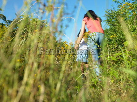 mother and daughter in field of