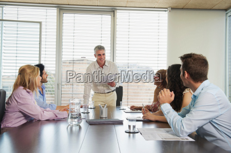 group of people in discussion in
