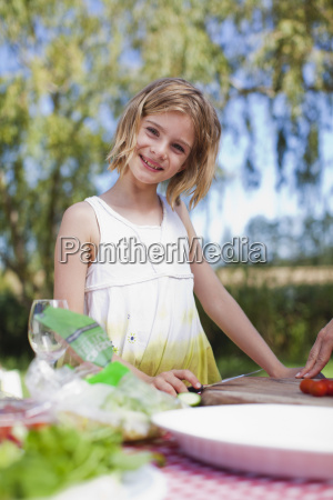 young girl making picnic lunch