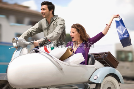 couple driving home from shopping