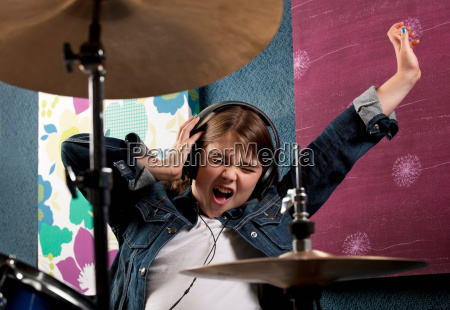 girl listening to headphone with drums