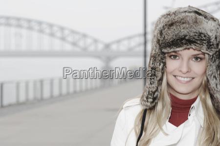 woman wearing fur hat by urban