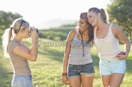three young female friends posing for