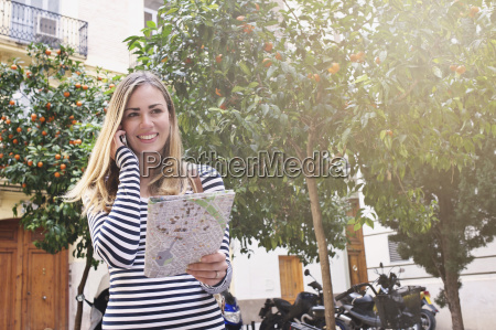 young female tourist with map and
