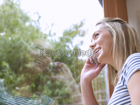 woman talking on cell phone at