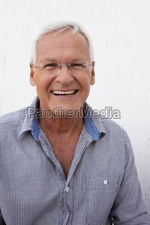 senior man smiling to camera