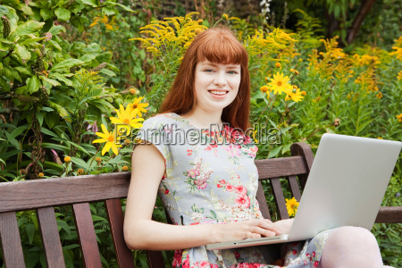 woman working on laptop on