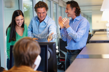 business team closing a deal happy
