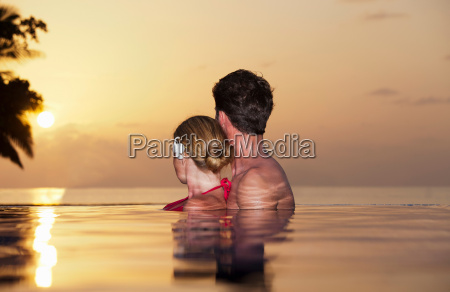 couple embracing in infinity pool