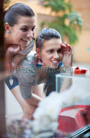 young women window shopping