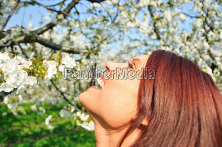 close up of woman laughing outdoors
