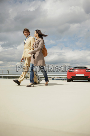 couple walking on park deck with