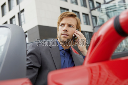 man on phone in his electric