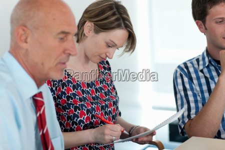 businesswoman making notes in conference