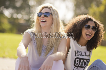 two young female friends laughing in
