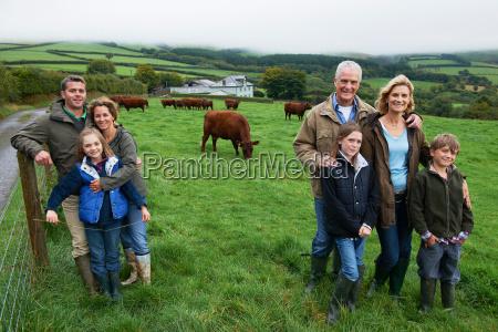 family on farm in a field