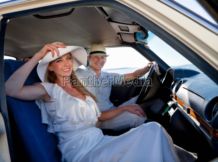 newlywed couple riding in car