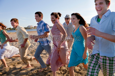 people running on beach together