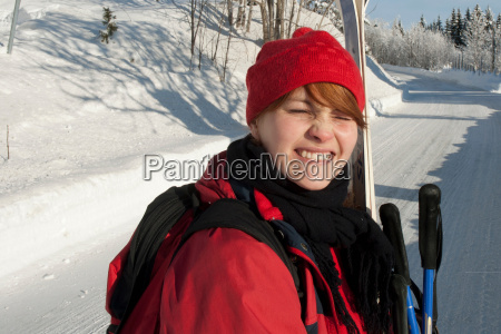 woman riding ski lift