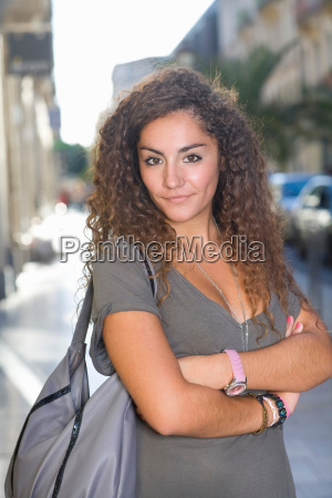 portrait confident young woman in street