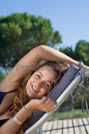 portrait young woman in lawn chair
