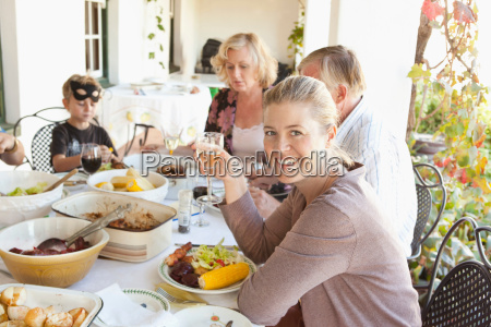 family eating at table outdoors