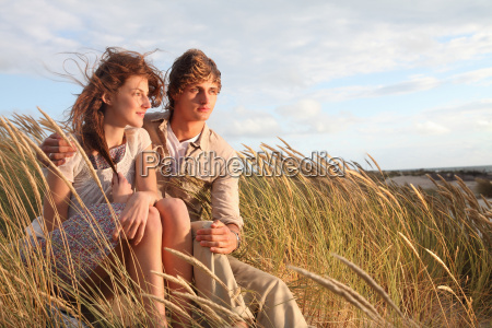 young couple in the dunes at