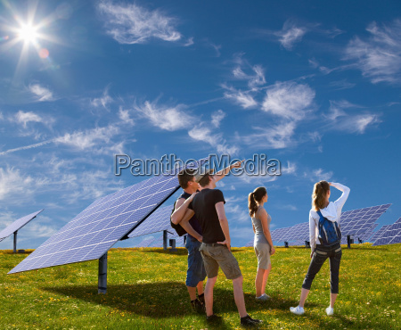 people standing in field by solar