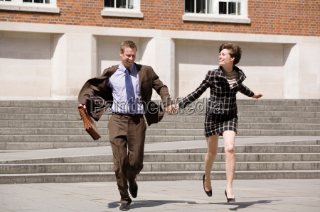 business people holding hands outdoors