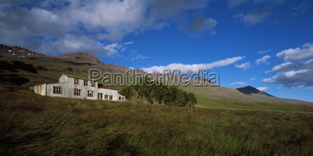 house in foothills under blue sky