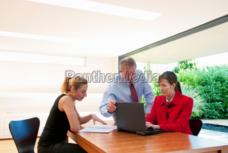 three business people check data