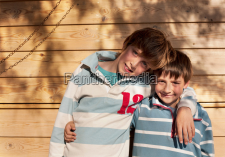 two boys arms round each other