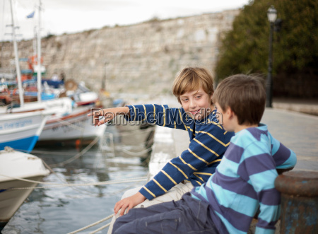 boys in harbour older one pointing