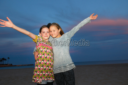 girls at sunset on the beach