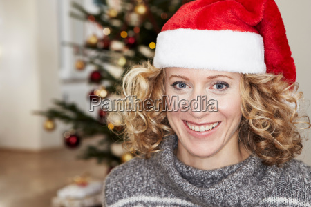 woman in front of xmas tree