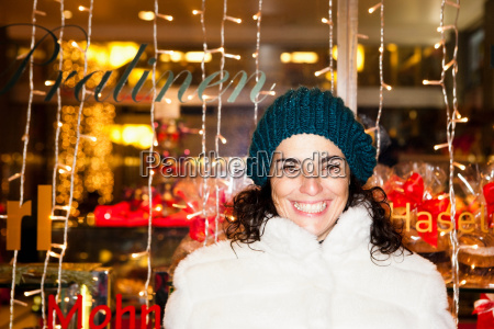 woman standing in front of shop