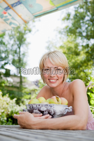 young woman holding a bowl with