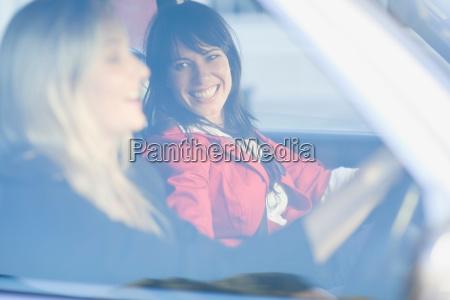 women sitting in a car