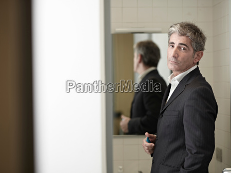 business man in bathroom