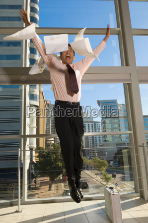 business man jumping in the air