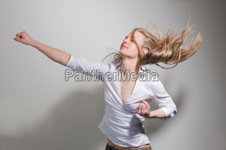woman punching in the air