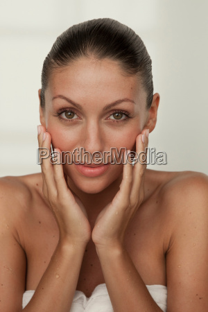 womans hands cupping her face