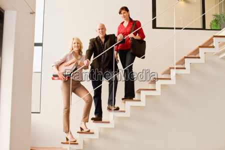 business people standing on steps