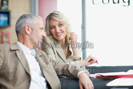 business people talking in lobby area