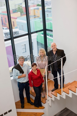 business people smiling on stairs