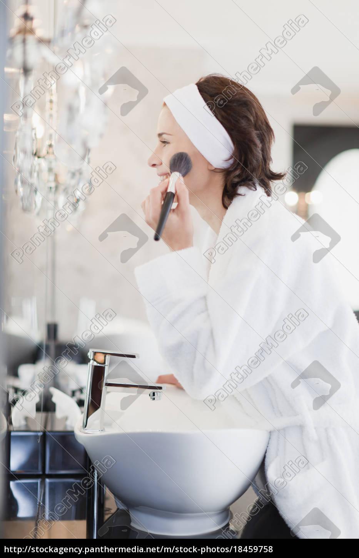 woman, in, bathrobe, applying, makeup - 18459758